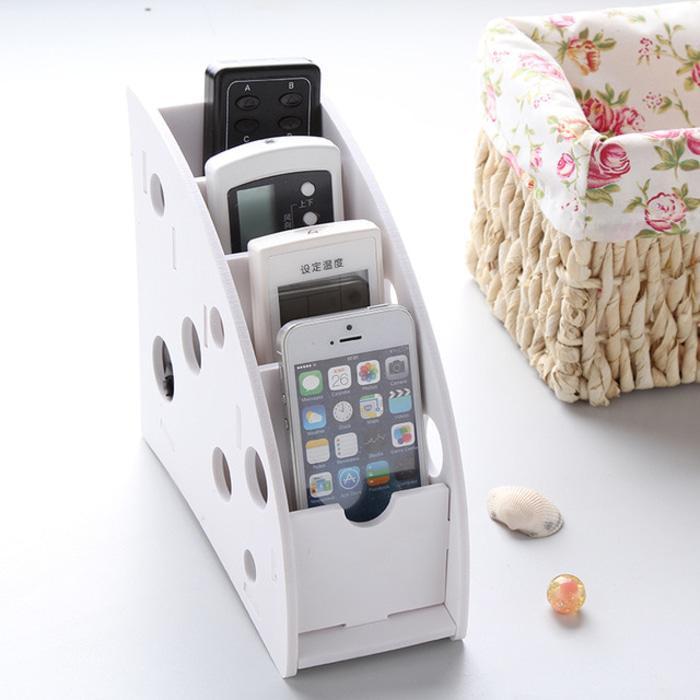 Tempat remote AC , TV , HP , / rak penyimpanan organizer warna putih KTR / rak penyimpanan organizer / rak penyimpanan organizer terbaru / ak penyimpanan organizer modern / ak penyimpanan organizer unik / ak penyimpanan organizer murah